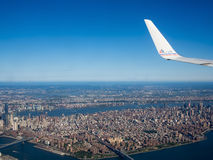 American Airlines plane flying over New York City Stock Photo
