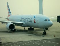 American Airlines Plane at Gate. American Airlines flight parked at gate on tarmac of international airport stock photography