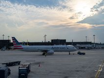 American Airlines plane taxiing on runaway with setting sun stock photography