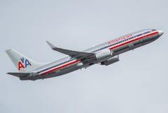American Airlines trafikflygplanstråle i flykten Royaltyfri Foto
