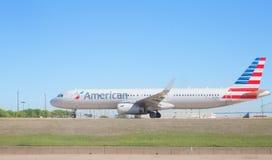American Airlines voyagent en jet Image stock