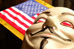 American Anonymous. BELGRADE, SERBIA , JULY 6, 2014: Photo of Vendetta mask with American flag .This mask is a well-known symbol for the online hacktivist group Stock Photo