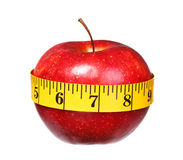 American apple with measuring tape lose weight isolated Royalty Free Stock Photos