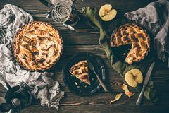 American apple pies on dark wooden table stock photography