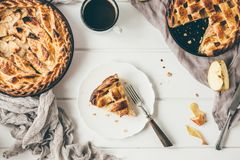 American apple pies on white wooden table Royalty Free Stock Photo