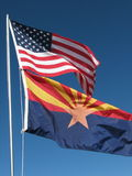 American/Arizona flags. The arizona and american flags fly proudly in the breeze Stock Photos