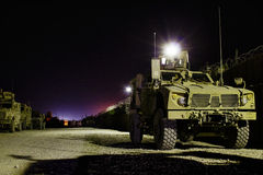 American armored vehicles in Afghanistan at night. An American armored vehicle parked at night in an american training camp near Mazari Sharif, Afghanistan Royalty Free Stock Photos