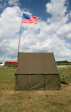 American army tent with national flag. American army tent on the airfield with american flag and fragments of planes behind stock photo