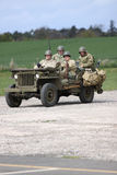 American army world war 2 jeep. American Army WW2 jeep containing four GI soldiers at re-enactment day Royalty Free Stock Images