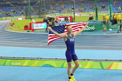 American athlete celebrates with American flag Stock Photography