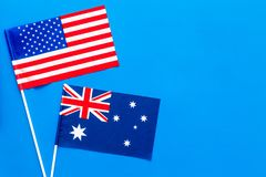USA-Australia relations. Country cooperation. American and Australian flags on blue background top view copy space Stock Photos