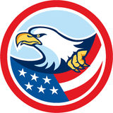 American Bald Eagle Clutching Flag Circle Retro. Illustration of a bald eagle clutching an american stars and stripes flag set inside circle on isolated Stock Images