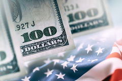 American Banking Concept. American Dollars and United States Of America Flag Royalty Free Stock Photo