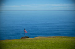 American banner in front of pacific ocean Stock Photo