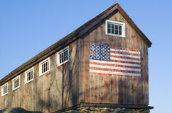 American Barn. New England Barn with American flag painted on side Stock Images