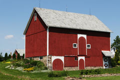 American Barn. Midwest Michigan American Red Barn with white trim and flower garden royalty free stock photo