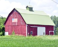 American barn. Barn on a farm in northern Michigan with American Flag Stock Photography