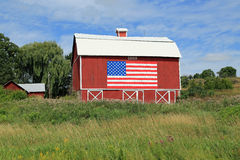 American Barn. Restored barn in the Midwest, originally built in 1889, displaying an American Flag Royalty Free Stock Images