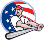American Baseball Player Batting Cartoon. Cartoon illustration of a baseball player with bat batting facing front set inside circle with stars and stripes flag Royalty Free Stock Photography