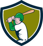 American Baseball Player Batting Crest Cartoon. Illustration of an american baseball player ready to bat set inside shield crest on  background done in cartoon Stock Photo