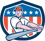 American Baseball Player Batting Shield Cartoon. Illustration of an american baseball player batter hitter batting with bat set inside shield crest with stars Royalty Free Stock Images