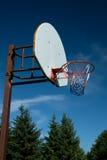 American Basketball Hoop against Blue Sky. An American red-white-and-blue Basketball Hoop Against a Blue Sky Stock Photography