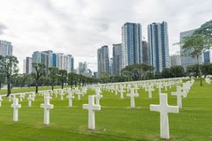 The American Battle Monuments Commission. Manila American Cemetery and Memorial. Landscape. Skyscraper in Background royalty free stock photo