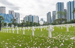 The American Battle Monuments Commission. Manila American Cemetery and Memorial. Landscape. White Air Balloon on the white cross stock photo
