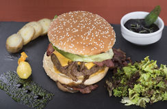 American beefburger served on a slate plate 2 stock image