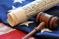 American Beginnings. Portrayal of American governmental beginnings with gavel, US Constitution, and flag royalty free stock image