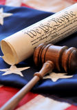 American Beginnings. Portrayal of American governmental beginnings with gavel, US Constitution, and flag stock photo