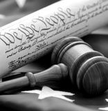 American Beginnings. Portrayal of American governmental beginnings with gavel, US Constitution, and flag. Black and white royalty free stock image