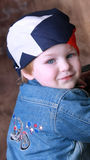 American Biker. Young Boy, Toddler wearing American Flag bandana and motorcycle jean jacket, wanting to be like daddy stock photos
