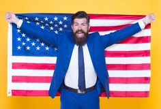 American by birth. Rebel by choice. Businessman concept. Confident businessman handsome bearded man in formal suit hold. Flag USA. Successful businessman well royalty free stock photos