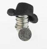 American Bison nickel with a stack of nickels and cowboy hat. The 2005 Westward Journey Nickel Series of the American Bison with a cowboy hat on a stack of stock images