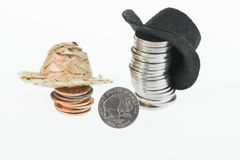 American bison nickel, straw hat, cowboy hat and coins Stock Photos