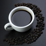 American Black Coffee With Beans Royalty Free Stock Photos