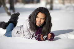 American black female lying in the snow Royalty Free Stock Photography