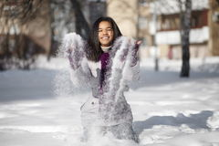 American black female lying in the snow Stock Photos