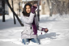 American black female sitting in the snow Royalty Free Stock Images
