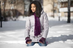 American black female sitting in the snow Royalty Free Stock Image