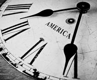 American black and white clock. Weathered and cracked, a great US ticking time concept, image has many uses Royalty Free Stock Photography