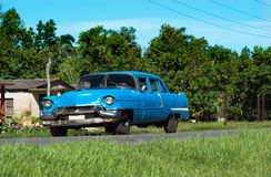 American blue Chevrolet classic car on the country road in Santa Clara - Serie Cuba Reportage.  Stock Photo