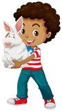 American boy holding a white rabbit Stock Images