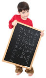 American Boy with Japanese Alphabet. Adorable six year old boy with chalkboard displaying Japanese alphabet. Kanji royalty free stock photo
