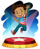 American boy jumping up on stage Stock Photo