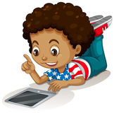 American boy using computer tablet Stock Image