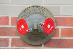 American brass standpipe with two red caps . New York. USA. royalty free stock image
