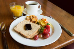American breakfast. Typical american hearty breakfast of toast, potato, fruits and juice Stock Image