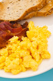 American breakfast, bacon and scrambled egg Stock Image